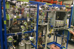 The main section of the Novomer system which includes a reactor, membrane separation, polymerizer, and controls needed to run the fully automated system which converts waste carbon dioxide into valuable chemicals.