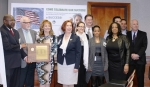 DOE employees gather for an award recognizing EM's Recovery Act Team.