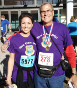 Jim Kopotic and his daughter Lauren pause for a photo after a race that raised money for cancer research and treatment.