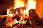 Burning firewood can keep you warm and cozy while keeping your thermostat and electricity use low. | Photo courtesy of ©iStockphoto.com/Pgiam.