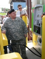 Major General Allen Tackett of the National Guard's 130th Airlift Wing dispenses the first fill-up of hydrogen fuel from the Yeager facility.