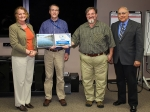From left, Elaine Diaz, Office of River Protection (ORP) acting chief engineer; John Vienna, Pacific Northwest National Laboratory scientist; Albert Kruger, ORP glass scientist; and Kevin Smith, ORP manager.