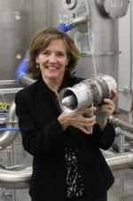 Shirley Coates Brostmeyer holds FTT's twin-spool turbofan, the most efficient micro-turbine of its size   credit Frank Serio