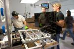 Workers at Abound Solar -- who are about to get more than 1,000 new colleagues -- make a thin-film solar panel. | Photo courtesy of Abound Solar