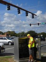 A worker synchronizes a traffic light on State Road A1A in St. Augustine, FL. | Energy Department Photo |