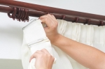 Installing blinds or draperies can help you save on cooling costs during the summer months. | Photo courtesy of ©iStockphoto.com/powershot