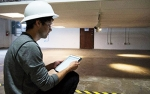 Photo of a man evaluating a connected lighting system.
