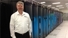 Project director Buddy Bland stands by Titan, the hybrid-architecture Cray XK7 system at Oak Ridge Leadership Computing Facility.
