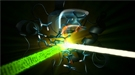 An optical laser (green) excites the iron-containing active site of the protein cytochrome c, and then an X-ray laser (white) probes the iron a few femtoseconds to picoseconds later.