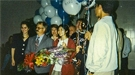 Candice Kamachi (in red coat) and her teammates were greeted as they arrived home in California after winning the 1996 National Science Bowl® in Washington, D.C.