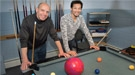 Brookhaven Lab physicist Alexander Bazilevsky and RIKEN physicist Itaru Nakagawa use billiards and a bowling ball to demonstrate surprising results observed at the Relativistic Heavy Ion Collider's PHENIX detector when small particles collided with l...