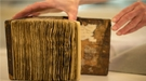Conservators at Stanford University Libraries removed the pages from the leather-bound cover of the book of hymns, and mounted each leaf in an individually fitted, archival mat.