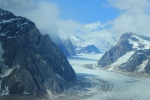 Ice Formed by Contact Freezing: Pressure Matters, Not Just Temperature