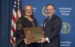 Deputy Secretary D. Brouilette presents Dr. Alveda Knight an Appreciation Award at the Special Observance - MLK Day program, January 25, 2018