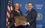 Deputy Secretary D. Brouilette presents Dr. Alveda Knight an Appreciation Award at the Special Observance - MLK Day program, January 25, 2018