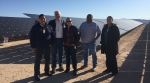 Touring First Solar's 250-megawatt Moapa Southern Paiute Solar Project located on the Moapa River Reservation. From left to right: Office of Indian Energy Director Chris Deschene, Office of Indian Energy Senior Policy Advisor Doug MacCourt, National Renewable Energy Laboratory Engineer Sherry Stout, Moapa Band of Paiutes Vice Chairman Greg Anderson, and Office of Indian Energy 48 Contiguous States Program Manager Sarai Geary. Photo from Sam Scucci, First Solar