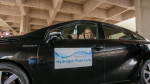 Secretary Rick Perry driving a fuel cell vehicle.