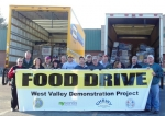 Volunteers from West Valley Demonstration Project gather before distributing items collected in an annual food drive.
