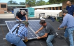 Lorain County Community College Instructors install PV modules on training roof labs during the Midwest Renewable Energy Association's Train-the-Trainer PV Instructor Institute course.