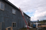 With DOE support, workers weatherize the exterior of the Lakeview Lodge in Minto, Alaska. Photo from Russell Snyder, Interior Regional Housing Authority, NREL 31796