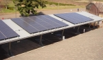 PV panels installed on Grand Ronde Tribal Housing Authority carport. Photo from GRTHA, NREL 31797