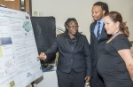 Akela Scott (left) and Taurean Houston (center), both seniors at South Carolina State University, explain their findings on species richness at SRS to Dr. Trina Halfhide, an instructor in environmental sciences from the University of the West Indies, St. Augustine, Trinidad and Tobago campus.