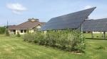 Six PV arrays generate 32 kW of energy to power 20 units at the AHA Sunrise Acres housing complex on the Saint Regis Mohawk Reservation. Photo by Rachel Sullivan, National Renewable Energy Laboratory.