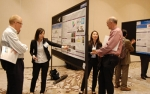 Photo of several people at a workshop poster session.