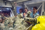 Workers treat sludge-bearing, transuranic waste from the Advanced Mixed Waste Treatment Project.