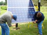 IBEW 725 electricians install solar panels at the union's hall in Terre Haute.   Photo courtesy of IBEW 725