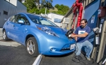 As the demand for electric vehicles goes up, charging stations become more prevalent -- here an electric vehicle owner uses a local charging station. | Photo Courtesy of the Energy Department.