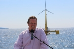 Assistant Secretary Dr. Danielson speaks in front of the VolturnUS floating wind turbine off the coast of Castine, Maine.