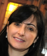 Marcela Carena is a Scientist III (senior scientist) at Fermi National Accelerator Laboratory (Fermilab) and a professor of physics at the University of Chicago. She attended Instituto Tecnologico Buenos Aires, Buenos Aires, Argentina, and the Instituto Balseiro, earning a diploma in physics; as well as San Carlos de Bariloche, Argentina, and the University of Hamburg, Germany, where she earned a Ph.D in high energy physics.