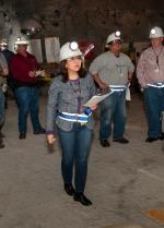 Dr. Monica Regalbuto, center, who is DOE's assistant secretary for environmental management, surveys progress on recovery efforts at EM's Waste Isolation Pilot Plant.