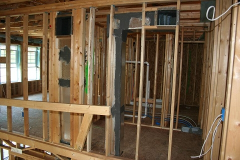 This photo shows framed walls and HVAC distribution systems.