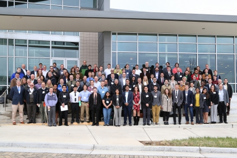 Image of a group of people in front of the NREL Cafe.