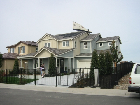 Photo of a home with a fence.