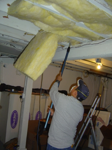 Image of a man insulating the ceiling of a home.