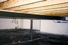 Photo of an unvented and insulated crawlspace.