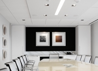 photo of a conference room, showing downlights in the ceiling above