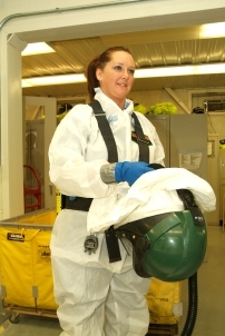 Recovery Act worker Rebecca Daniels, an ex-Marine, is a self-described tomboy who loves the challenge of working amid hazardous chemicals to clean up old buildings at the Paducah Site and prepare them for demolition.