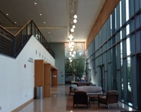 photo of a hospital waiting area, showing downlights in the ceiling above