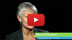 Still image from the Michigan partner YouTube video, showing Mary Templeton facing the camera.