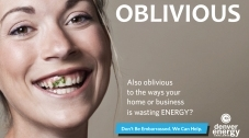 Advertisement for the Denver Energy Challenge, with a female smiling at the camera -- with something wrong with her teeth -- and the word 'Oblivious' at the side, and 'Also oblivious to the ways your home or business is wasting ENERGY?'