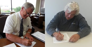Photo of WRA and Des Moines Water Works representatives signing onto the pilot program.
