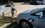 Plug-in electric vehicles and outdoor charging stations.