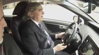 Image of Secretary Moniz test driving the Toyota Mirai.