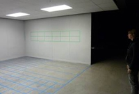 Photo of a lighting design lab space with a person standing at right.