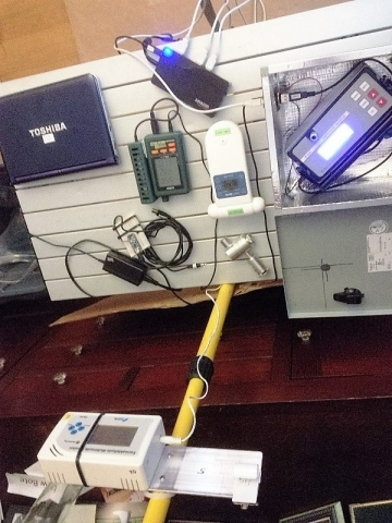 Photo of equipment mounted on a desk.