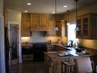 Photo of a kitchen with lit downlights.
